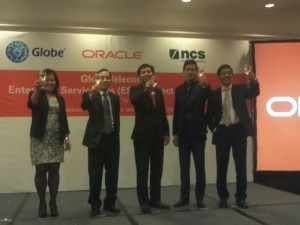 Globe Telecoms and Oracle Philippines Corporation officials during the ceremonial toast to symbolize the partnership between the two companies