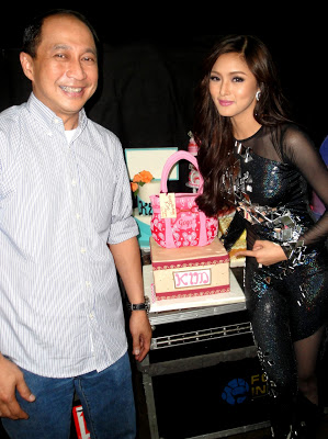 "The birthday girl, ""Primetime Princess"" Kim Chiu, receives the special cake prepared by Delfi during her birthday celebration in popular Sunday noontime show ASAP. At left is Delfi General Manager Mr. Josenilo Chincuanco."