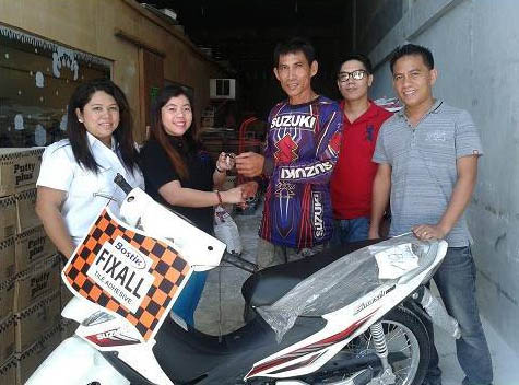 Bostik regional sales representative in Visayas Ms. Jo-ann Maringuran and Product Manager Citadel Dongel with Trinity Dynamics, Inc. representatives, awarding the motorcycle to winner Sergio Condrillon (center) of Cebu City.