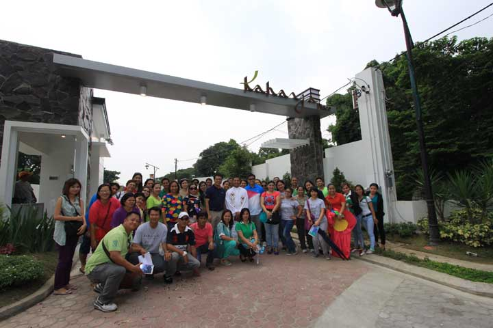 NLI staff and guests pose for a photo at the entrance of Kahaya Place after the successful and fun fiesta-themed Grand Open House event.